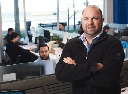 Ken in Camden office - Employees in the background